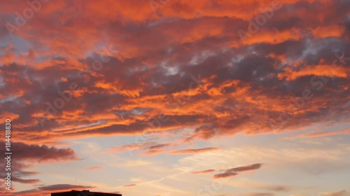 Foto op Canvas Baksteen evening sky with dramatic sunset clouds over the city house zoom