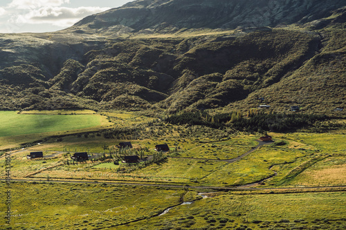 Foto op Canvas Gras beautiful landscape with grassy hills and houses in Iceland