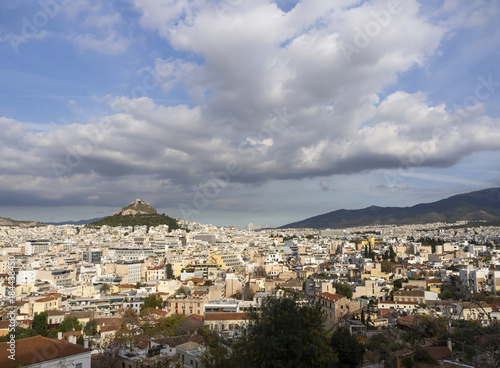 Staande foto Athene View of the Likavitos hill from the streets of the Athens district of Anafiotica near Acropolis