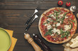 flat lay with arranged italian pizza, cutlery and various ingredients on wooden surface - 184445445