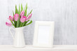 Fresh pink tulips bouquet and photo frame - 184449886