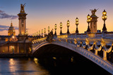 Pont Alexandre III Bridge and illuminated lamp posts at sunset with view of the Invalides. 7th Arrondissement, Paris, France