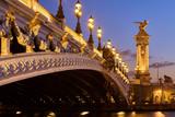 Close-up of Pont Alexandre III Bridge and illuminated lamp posts at sunset. 7th Arrondissement, Paris, France - 184449892
