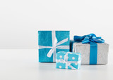 Gift boxes with ribbon on white