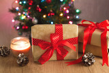 Gift boxes with ribbon on christmas tree background
