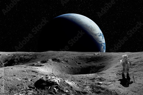 Astronaut on the Moon. Planet earth in background. Elements of this image furnished by NASA - 184466294