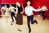 Positive people dancing twist in pairs - 184469615