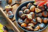 Roast chestnuts in a pan closeup. - 184469883