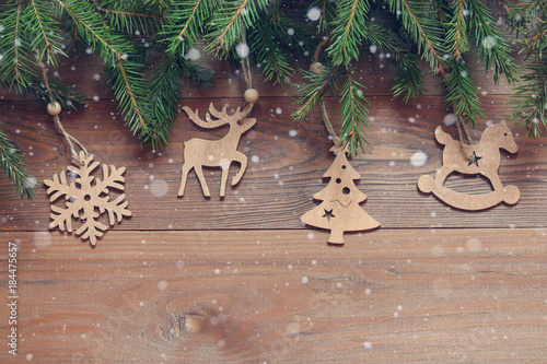 Fotobehang Hert Christmas background. Wooden figures on the fir branches
