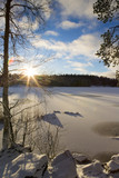 Winter landscape. Sunshine with flare effect. Snow covered lake ice and ground.  - 184477033