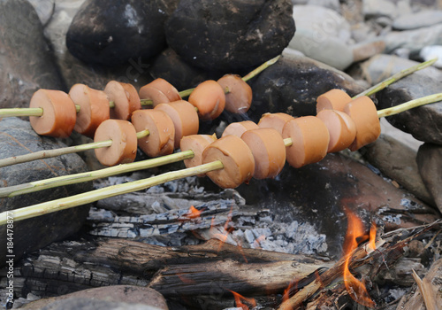 r cooking wurstel during scout camp with technique called trappe