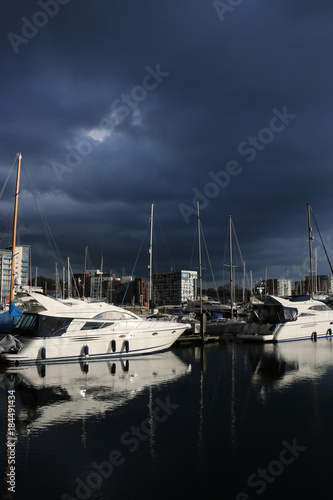 Plagát Ipswich waterfront marina with storm clouds