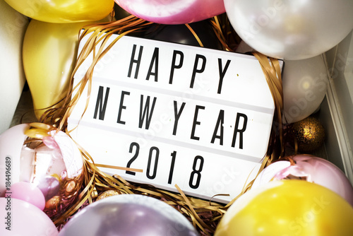 Closeup of Happy New Year 2018 board in a party
