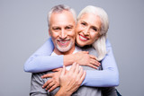 Fototapety Close up portrait of happy excited senior couple, they are embracing and smiling, they love each other