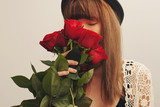 Portrait of girl closed eyes smelling a red rose buds. - 184539004