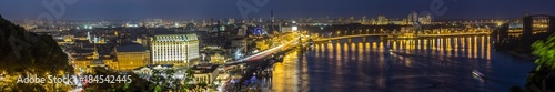 Poster Kiev Kyiv (Kiev) city, the capital of Ukraine at night beside the Dnipro (Dniepr) river with reflection in water
