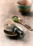 Traditional, bamboo tea whisk and an organic Matcha Tea.