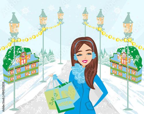 Fotobehang Lichtblauw beautiful woman doing the shopping in winter