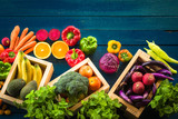 Top view of fresh vegetables on table, Fresh vegetables in wooden container with copy space