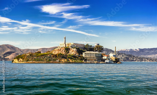 Alcatraz Island and former federal penitentiary on sunny day in San Francisco Bay, California