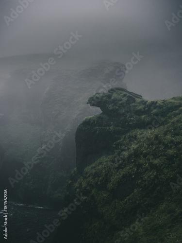 In de dag Grijs green misty cliffs in Western Fjords in Iceland