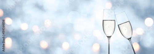 canvas print picture Abstract blue winter background with champagne and bokeh