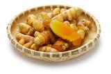 fresh whole turmeric on bamboo saucer - 184566270