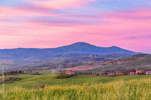 Sunrise over the mountains and valleys in Tuscany in Italy Poster