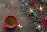 Red cup of coffee and fir branch with Christmas decorations on old wooden  background. - 184580824