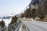 Mountain road  in Swiss alps at an overcast winter day. Val Bregaglia, canton Graubunden, Switzerland. - 184581023