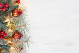 Fir branch with Christmas decorations on old wooden shabby background with copy space for text - 184581297