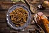 Cabbage stew with meat, mushrooms and dried plums - traditional polish dish - 184582026