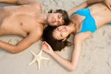 Couple lying on beach - 184599833