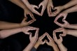 many diverse women's hands symbolize unity and empowerment