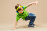 break dance kids. little break dancer showing his skills in dance studio. Hip hop dancer boy performing over studio background