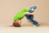 break dance kids. little break dancer showing his skills.