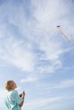 A boy flying a kite - 184602086