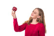 Pretty blonde girl with red apple in her hand, white background