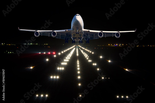 Passenger aircraft takes off from the night airport runway