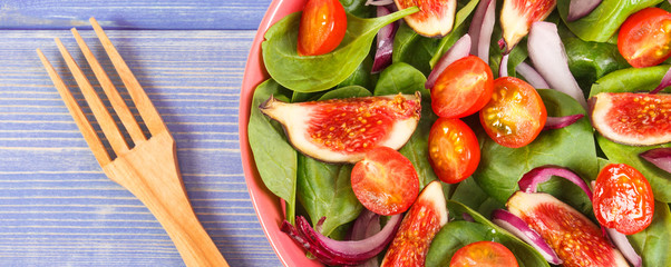 Fresh prepared fruit and vegetable salad with wooden fork, healthy lifestyle and nutrition concept