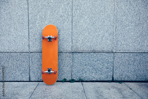one skateboard against gray wall Poster