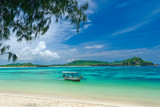 tropical beach in island Lombok, Indonesia with boat and turquoise lagoon.