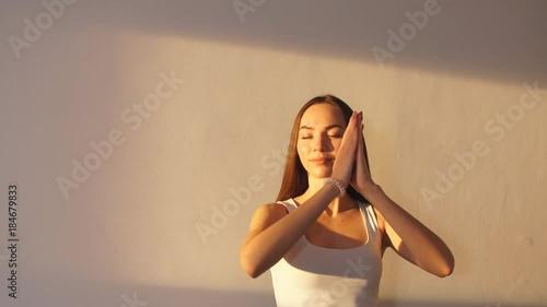 Plakat Woman practicing yoga in a studio indoors.