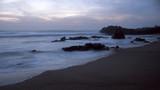 Rocky sea beach at dusk - 184683405