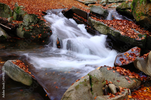 Foto op Canvas Chocoladebruin Waterfall in the autumn beech forest
