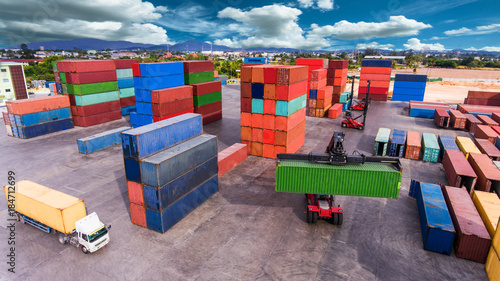 Aluminium top view of container storage & works stacking tier to tier by the forklift, unit containers are standing by for transfer the cargo & shipment to the port upon the ship carrier arrive in terminal