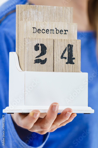 Hand holding calendar with christmas date Poster