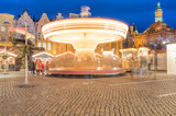 Spinning carousel on christmas fair in old town of Gdansk.