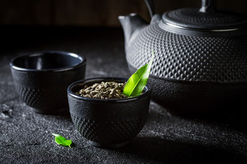 Closeup of green tea with teapot and cup
