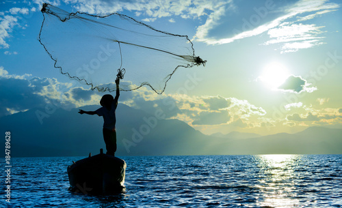 Plexiglas Zonsopgang fishing activities and labor worker